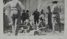 Photograph of large group of people having a picnic in canyon