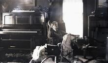 Charles M. Russell Seated in Living Room