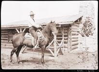 Charles M. Russell on a Horse