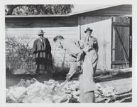 Three Unknown Men in front of Barn
