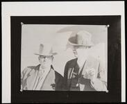 Charles M. Russell and Unknown Man Smoking