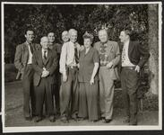 Con Price with Group of Unknown People