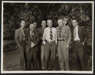 Con Price with Group of Unknown Men