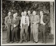 Con Price and Homer Britzman with Group of Unknown Men