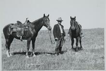Charles M. Russell with Two Horses
