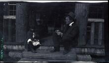 Charles M. Russell on Porch with Child