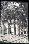 Group of People by Picket Fence