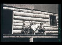 People Seated on Porch