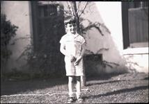 Young Boy Standing by House
