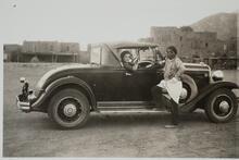 Man Standing by Car near Pueblo