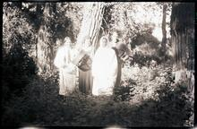 Two Men and Two Women Standing by Trees