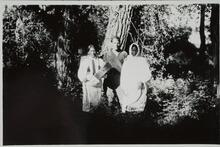 Two Men and a Woman Standing by Trees