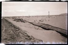 Fallen Fence in Sand