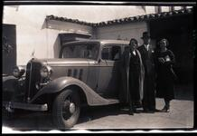 Three People in Front of Car