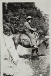 Charles M. Russell Riding a Horse