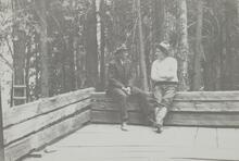 Charles M. Russell and Friend on Porch