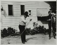 Charles M. Russell and Harry Carey Twirling Lassos