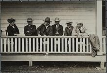 Charles M. Russell Seated with Friends