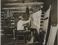 Charles M. Russell Working on Painting in Studio