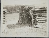 Charles M. Russell Standing Near Wall