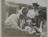 Charles M. Russell with Two Women and a Young Child