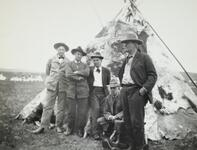 Charles M. Russell and Friends Near Tipi