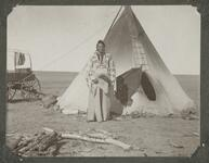 Young Boy in Front of Tipi