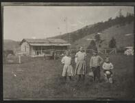 Four Children in Front of Cabin