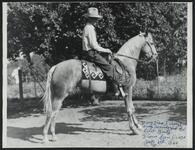 Con Price on a Horse