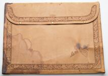 Charles M. Russell's Portfolio with intricate floral designs around the edges and flap