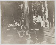 Charles M. Russell with father Charles S. Russell along with Austin and Isabel Russell