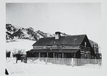 Photograph of Cabin in Snow