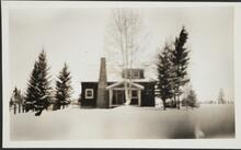 Photograph of House in Snow