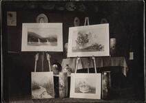 Four paintings on easels