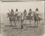 Five Indians on Horses with Prisoner