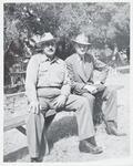 Homer Britzman seated with Unknown Men