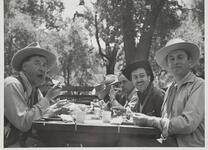 Group of Unknown Men Eating