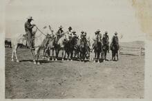 Group of Unknown Men and Child on Horses
