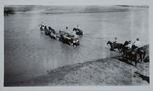 Wagons and Men crossing River