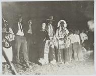 Men and Women around Bonfire