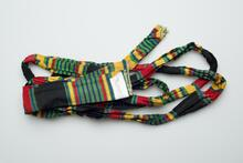 Multi-colored sash with yellow, red, blue, green, and black stripes