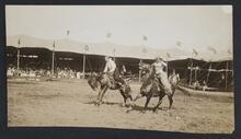 Two Men on Bucking Horses