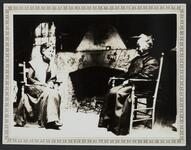 Two Women by Fireplace
