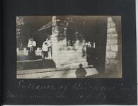 Two Women and Two Children near Stone Column