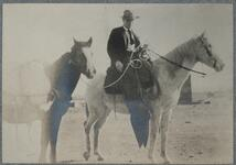 Charles M. Russell on Horse with Pack Horse