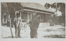 C. S. Russell with Man Holding String of Fish