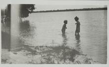 Two Children Playing in Water
