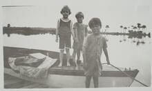 Three Children by Boat