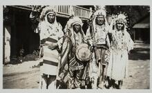 Four Indians in Traditional Clothing