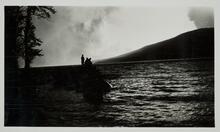 Silhouettes of Men on Lake